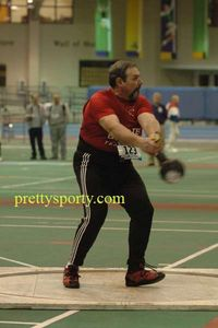 Bob Cedrone (GBTC/Canton MA) winds up in the M50 weight throw.