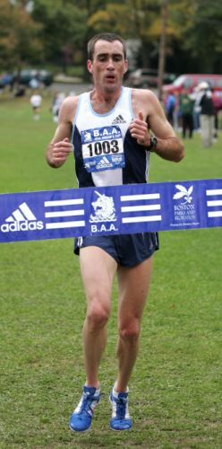 Mark Carrol wins the 8-kilometer men's race at the Mayor's Cup in Boston on Oct. 24, 2004.