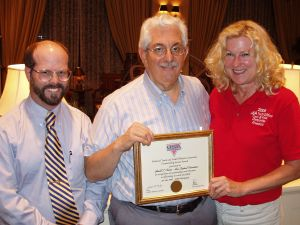 Gerry Cantor (center) receives officials service reward from Pat Lavelle and Laurie Boemker at USATF-NE annual meeting.