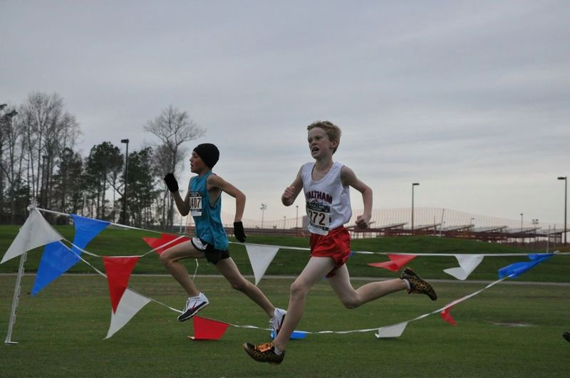 ba58e0cbf5f Daniel O Donoghue runs to an All-American 24th palce in the Midget Boys  race (photo  Emer)