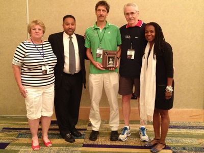 Director Steve and President Steve receive the associations Award, flanked by Associations Committee chair Karen Krsak, USATF CEO Max Siegel, and USATF President Stephanie Hightower (Bill Roe photo)