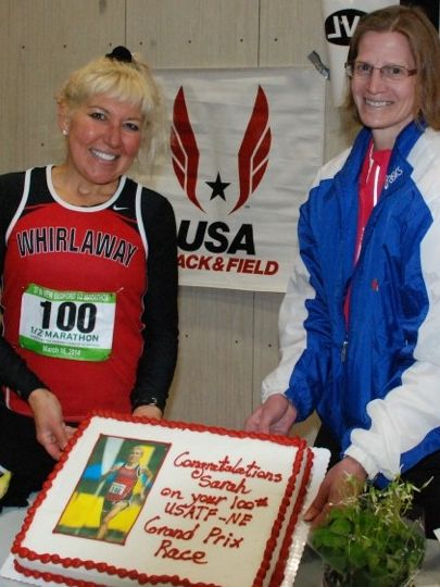 USATF-NE treated Sarah Prescott to a cake to celebrate completing her 100th consecutive NE GP championship. (Photo: Tom Derderian)
