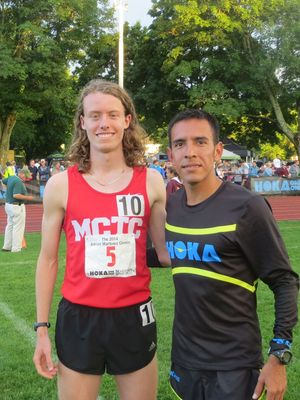 Garrett O'Toole with Olympian and 2014 USA Champion Leo Manzano after the Adrian Martinez Mile. (photo by Chris Lotsbom)