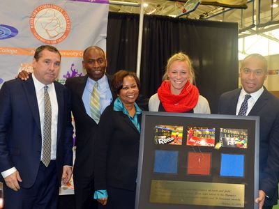 Meet director Mark Wetmore, Reggie Lewis Center director Keith McDermott, RCC President Dr. Valerie Robinson, and 2014 USA Indoor Pole Vault Champion Mary Saxer present a plaque of RLTAC highlights to Governor Deval Patrick. (Photo: Courtesy Roxbury Community College)