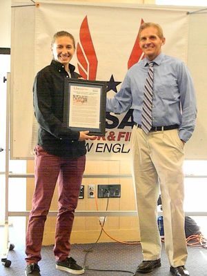 Carly Muscaro receives the Athlete of the Month plaque from Dr. John Oleski. (USATF-NE photo)