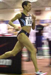 Regina Jacobs on her way to claim the 2 Mile American Record at the Boston Indoor Games. Photo by Stanley Hu.